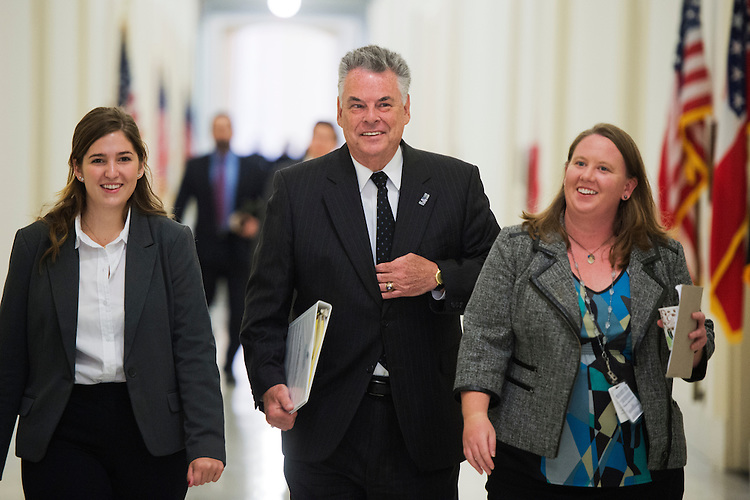 "UNITED STATES - SEPTEMBER 17: Rep. Peter King, R-N.Y., makes his way to a House Homeland Security Committee hearing in Cannon Building titled ""Worldwide Threats to the Homeland,"" September 17, 2014. James Comey, FBI Director, Jeh Johnson, Secretary of Homeland Security, and Matthew Olsen, National Counterterrorism Center Director, testified. (Photo By Tom Williams/CQ Roll Call)"