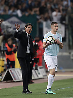 Calcio, Serie A: S.S. Lazio - A.S. Roma, stadio Olimpico, Roma, 15 aprile 2018. <br /> Lazio's coach Simone Inzaghi (l) speaks to his players during the Italian Serie A football match between S.S. Lazio and A.S. Roma at Rome's Olympic stadium, Rome on April 15, 2018.<br /> UPDATE IMAGES PRESS/Isabella Bonotto