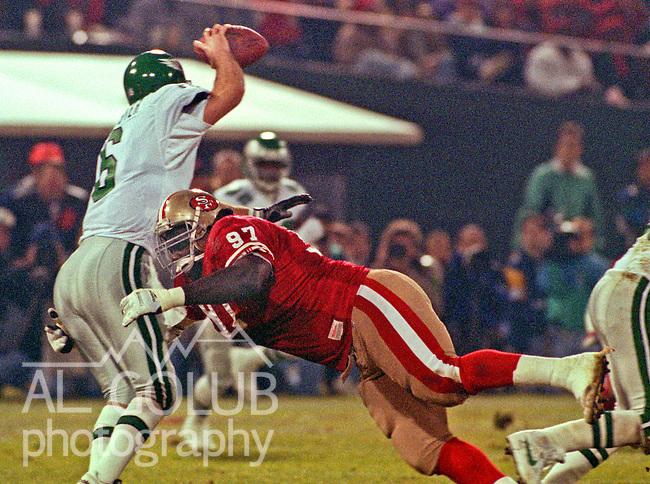 San Francisco 49ers vs. Philadelphia Eagles at Candlestick Park Monday, January 3, 1994.  Eagles Beat 49ers 37-34-OT.  San Francisco 49ers nose tackle Ted Washington (97) tackles Philadelphia Eagles quarterback Buddy Brister (6).