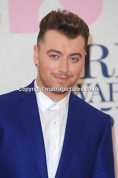 NON EXCLUSIVE PICTURE: PAUL TREADWAY / MATRIXPICTURES.CO.UK<br /> PLEASE CREDIT ALL USES<br /> <br /> WORLD RIGHTS<br /> <br /> English singer-songwriter Sam Smith attending the BRIT Awards 2015 at the O2 Arena, in London.<br /> <br /> FEBRUARY 25th 2015<br /> <br /> REF: PTY 15627