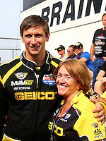 Aug. 18, 2013; Brainerd, MN, USA: NHRA top fuel dragster driver Morgan Lucas (left) with mother Charlotte Lucas during the Lucas Oil Nationals at Brainerd International Raceway. Mandatory Credit: Mark J. Rebilas-