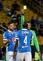 BOGOTA - COLOMBIA - 05 - 02 - 2017: Juan Ponton (Der.), arbitro, muestra tarjeta amarilla a Anier Figueroa (Izq.) jugador de Millonarios, durante partido de la fecha 1 entre Millonarios y Deportivo Independiente Medellin, de la Liga Aguila I-2017, jugado en el estadio Nemesio Camacho El Campin de la ciudad de Bogota.  / Juan Ponton (R), referee, shows yellow card to Anier Figueroa (L), player of Millonarios, during a match between Millonarios and Deportivo Independiente Medellin, for the date 1 of the Liga Aguila I-201/ at the Nemesio Camacho El Campin Stadium in Bogota city, Photo: VizzorImage / Luis Ramirez / Staff.