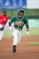 Mason Davis (7) of the Greensboro Grasshoppers legs out a triple in the top of the first inning against the Kannapolis Intimidators at CMC-Northeast Stadium on June 9, 2015 in Kannapolis, North Carolina.  The Intimidators defeated the Grasshoppers 6-4.  (Brian Westerholt/Four Seam Images)