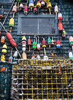 Colorful lobster buoys on a coastal shack, Bernard, Maine, USA