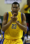 Jefferson's Noah Kone-Nelson claps after prevented North Eugene from crossing the half court line in the 5A boys state championship at McArthur Court Friday March 13, 2009.