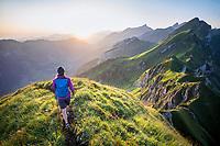 Hiking on the Rophaien ridgeline at sunrise, Switzerland
