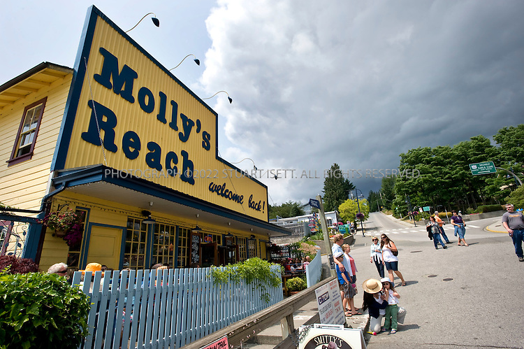 "7/6/2008--Gibsons, British Columbia, Canada..Gibsons, a town of 4,000, is considered the gateway to the Sunshine Coast north of Vancouver. Molly's Reach is a historic diner and was featured for 19 years on CBC's famous TV show, ""The Beachcombers"". Dishing up old favorites like halibut and chips, Molly's Reach has decorated its walls with photographs of the show's cast a crew. The restaurant can be accessed either by boat or by car. ..The rocky Sunshine Coast of British Columbia is just two hours northwest of Vancouver and can only be reached by ferry from Horseshoe Bay near Vancouver. Much of the coastline is accessible by boat only and protected as provincial parkland and visitors have an array of activities to choose from including hiking, kayaking, diving and sailing. Hotels, resorts and B&Bs offer a range of accommodation for travelers...©2008 Stuart Isett. All rights reserved."