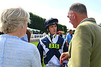 Jockey of Rainfall, Harry Bentley talks to trainer Henry Candy in the Winner's enclosure after winning The First Carlton Fillies' Handicap during Horse Racing at Salisbury Racecourse on 15th August 2019