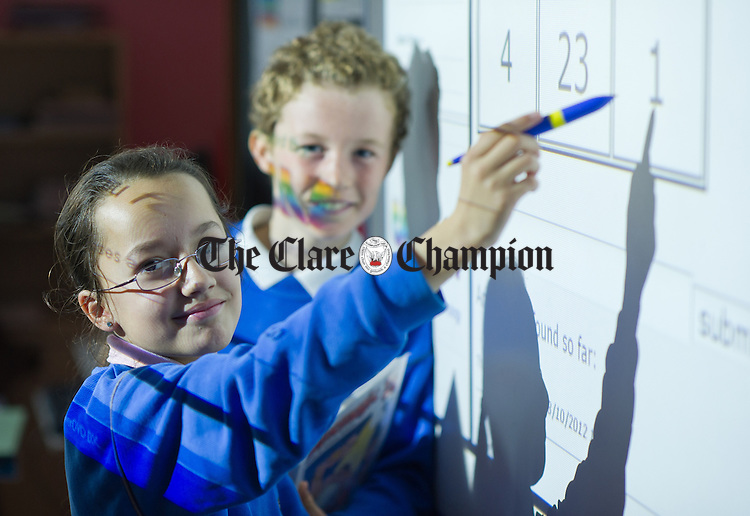Albulema Aliu and Niall Walsh working on Mathematics problems at the Holy Family Senior school in Ennis. Photograph by John Kelly.
