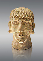 First half of the 6th century B.C Etruscan clay head of a young man made in Chiusi, inv 94612, National Archaeological Museum Florence, Italy , against grey