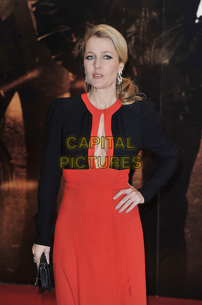 "Gillian Anderson.The ""Mission : Impossible Ghost Protocol"" UK premiere, BFI Imax cinema, Waterloo, London, England..December 13th, 2011.Mi4 MI:4 half 3/4 length black clutch bag jacket dress red plunging neckline cleavage .CAP/MAR.© Martin Harris/Capital Pictures."