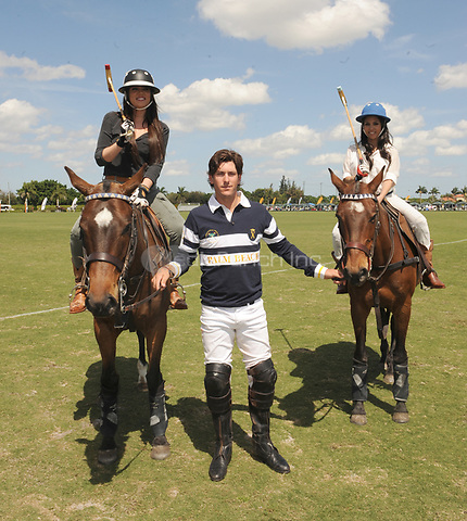 WEST PALM BEACH, FL - MARCH 14:  Kourtney Kardashian and Scott Disick with their young son Mason Dash Disick in tow take a polo lesson with top ranked american polo player Nic Roldan. The couple was joined by sister Khloe Kardashian. The kardashian clan had a great afternoon, riding horses and joking around while they sipped champagne at the International polo club palm beach on March 14, 2010 in Wellington, Florida.<br /> <br /> People:  Khloe Kardashian_Nic Roldan_Kourtney Kardashian<br /> <br /> Transmission Ref:  FLXX<br /> <br /> Hoo-Me.com/ MediaPunch
