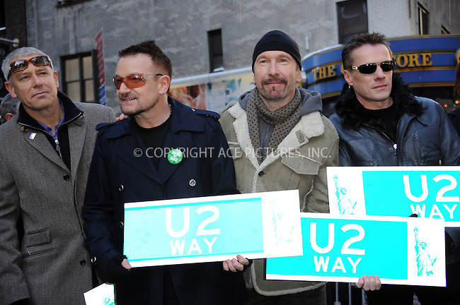 WWW.ACEPIXS.COM . . . . .  ....March 3 2009, New York City....Adam Clayton, Bono, The Edge and Larry Mullen Jr. at  the temporary re-naming of a section of 53rd Street 'U2 Way' in Manhattan on March 3 3009 in New York City.....Please byline: KRISTIN CALLAHAN - ACEPIXS.COM.... *** ***..Ace Pictures, Inc:  ..tel: (212) 243 8787..e-mail: info@acepixs.com..web: http://www.acepixs.com