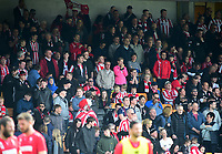 Lincoln City fans watch their team in action<br /> <br /> Photographer Andrew Vaughan/CameraSport<br /> <br /> The EFL Sky Bet League Two - Port Vale v Lincoln City - Saturday 14th April 2018 - Vale Park - Burslem<br /> <br /> World Copyright &copy; 2018 CameraSport. All rights reserved. 43 Linden Ave. Countesthorpe. Leicester. England. LE8 5PG - Tel: +44 (0) 116 277 4147 - admin@camerasport.com - www.camerasport.com