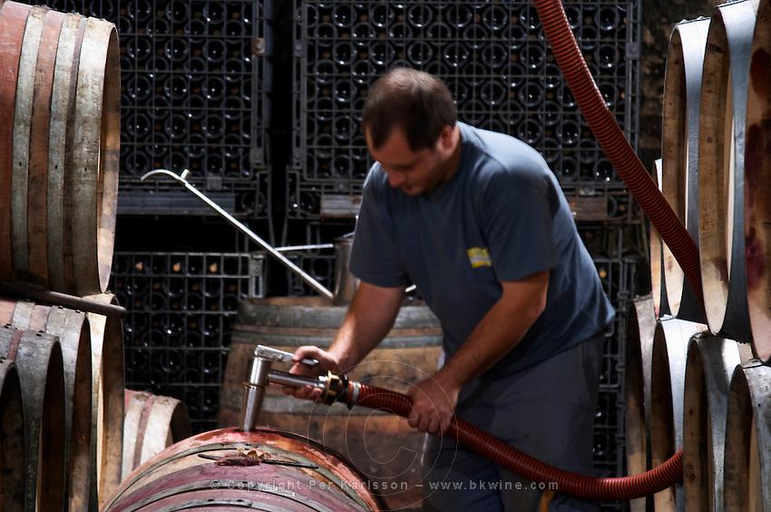 topping up wine barrels domaine parent pommard cote de beaune burgundy france