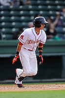 Shortstop Javier Guerra (31) of the Greenville Drive bats in a game against the Asheville Tourists on Friday, April 24, 2015, at Fluor Field at the West End in Greenville, South Carolina. Guerra is the No. 13 prospect of the Boston Red Sox, according to Baseball America. Greenville won, 5-2. (Tom Priddy/Four Seam Images)