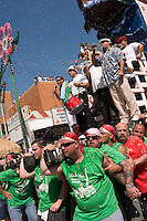 Brooklyn New York - 13 July 2008 - Capo leads the boat up Havameyer Street where it will, eventually, meet the Giglio. 120 Italian American men, adorned in the colors of the Italian Flag, carry the Giglio, and a similarly size boat, through the streets of WIlliamsburg, Brooklyn.  The Giglio and the boat meet, at the intersection of Havemeyer and North 8th Street to mark the Feast Day of fifth Century Saint Paulino, of Nola Italy.