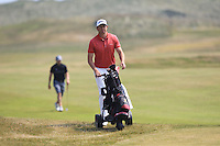 Robbie Cannon (Balbriggan) walking down the 2nd during Round 4 of the East of Ireland Amateur Open Championship sponsored by City North Hotel at Co. Louth Golf club in Baltray on Monday 6th June 2016.<br /> Photo by: Golffile   Thos Caffrey