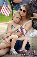 From left, Kate Hutchison, 4, and Dana Hutchison of Haycock, Pennsylvania listen as guest speaker Tom Applebach (not seen) makes remarks during the Quakertown Memorial Day Ceremony Monday May 30, 2016 at Quakertown Memorial Park in Quakertown, Pennsylvania. The parade was cancelled due to rain in the weather forecast. (Photo by William Thomas Cain)