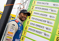 Aug 17, 2014; Brainerd, MN, USA; NHRA top fuel dragster driver Antron Brown poses by the countdown board during the Lucas Oil Nationals at Brainerd International Raceway. Mandatory Credit: Mark J. Rebilas-