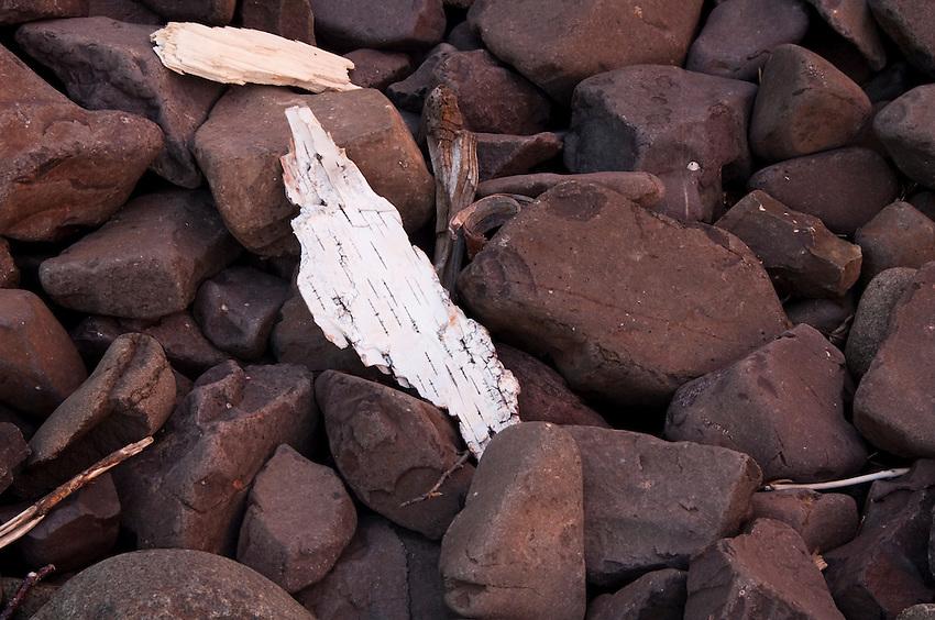 Birch bark and beach stones along Lake Superior shoreline in northern Minnesota.