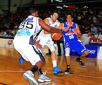 Hawks guard Chris Daniel and import Galen Young (left) beat Troy McLean (right) to the ball. NBL - Wellington Saints v Bay Hawks at TSB Bank Arena, Wellington, New Zealand on Friday, 3 June 2011. Photo: Dave Lintott / lintottphoto.co.nz