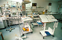 Premature infant in an high dependency intensive care cot in a special care baby unit.