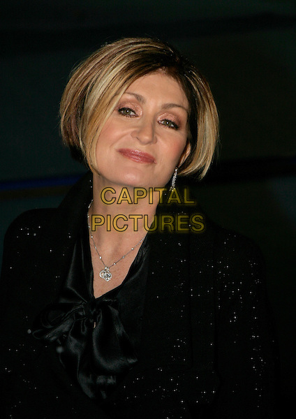 "SHARON OSBOURNE.""The Chronicles of Narnia: The Lion, The Witch & The Wardrobe"" - world premiere at the Royal Albert Hall, London, UK..December 7th, 2005.Ref: AH.headshot portrait black.www.capitalpictures.com.sales@capitalpictures.com.©Capital Pictures"