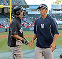 (L-R) Ichiro Suzuki (Yankees), Gosuke Kato,<br /> JUNE 14, 2013 - MLB :<br /> Ichiro Suzuki of the New York Yankees talks with Yankees second round draft pick Gosuke Katoh during batting practice before the Major League Baseball game against the Los Angeles Angels at Anaheim Stadium in Anaheim, California, United States. (Photo by AFLO)