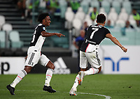 Calcio, Serie A: Juventus - Sampdoria, Turin, Allianz Stadium, July 26, 2020.<br /> Juventus'  Cristiano Ronaldo (r) celebrates after scoring with his teammate Juan Cuadrado (l) during the Italian Serie A football match between Juventus and - Sampdoria at the Allianz stadium in Turin, July 26, 2020.<br /> UPDATE IMAGES PRESS/Isabella Bonotto