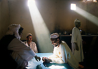 "Sudanese friends in the north converse in a private home where life is comfortable. In their civilized world, they are removed from the war in the south...Story Summary:.Sudan, the largest country in Africa, hosts a civil war between the Islamic North and the African South that has the highest casualty rate of any war since World War II...Two and a half million people have been killed in this insidious conflict.  It drags on because Southerners have no voice, and the Northerners have engineered ""The Perfect War"" where none of their people are killed...The North forces people out of the South by bombing them, burning their crops, and harassing them with gunships. They abduct their children and draft them to fight with the Northern army--forcing southerners to fight their own brothers...This story is particularly interesting now because there is a small window for peace in a civil war that has been dragging on since the end of colonial rule.  The war has always been about tribal issues and ideology... but more than that, it is about resources.  This clash over resources may bring peace.  The North controls the pipeline and the only port, and the South controls the land...The story of Sudan has always been the continual transference of wealth from the resources of the south to the elite few who live in the deserts of the north.  And the sucking sound in the middle of the country is from the corrupt government in northern Khartoum.."