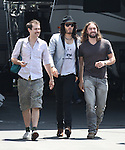 """5-18-09.Russell brand with his arm around his gay boyfriend walking into The Rouge Strip club for filming a scene for his new movie called """"Get Him to the Greek"""" with actor Colm Meaney & Jonah Hill in Los Angeles ca ...AbilityFilms@yahoo.com.805-427-3519.www.AbilityFilms.com."""