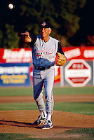 Former Atlanta Braves pitcher Phil Niekro throws out a pitch while managing the Colorado Silver Bullets during a 1995 game at Fiscalini Field in San Bernardino,California.(Larry Goren/Four Seam Images)