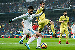 Isco Alarcon (L) of Real Madrid fights for the ball with Manuel Trigueros Munoz (R) of Villarreal CF during the La Liga 2017-18 match between Real Madrid and Villarreal CF at Santiago Bernabeu Stadium on January 13 2018 in Madrid, Spain. Photo by Diego Gonzalez / Power Sport Images
