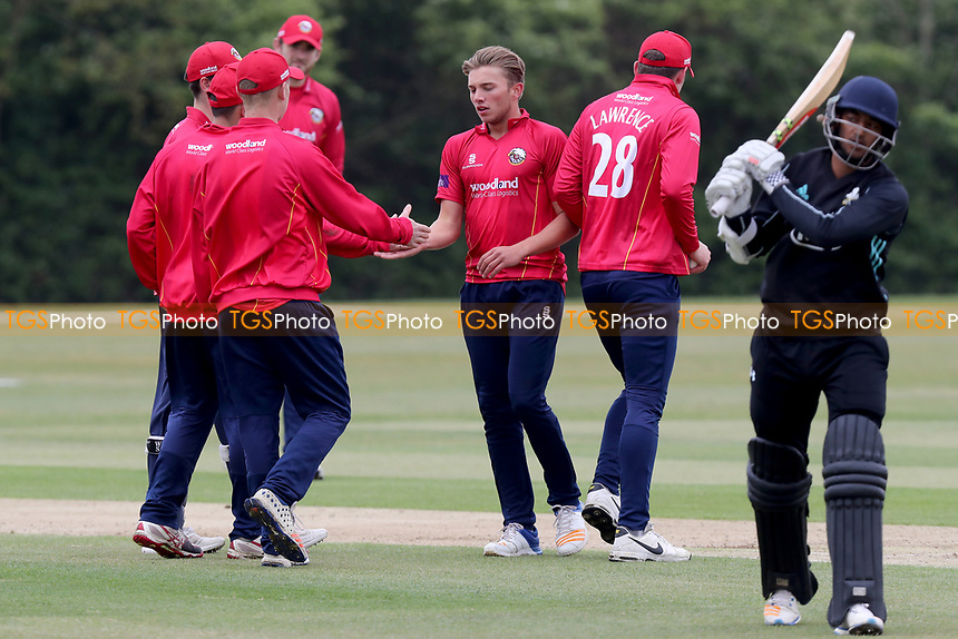 Aaron Beard of Essex is congratulated by his team mates having taken the wicket of GS Virdi during Essex CCC 2nd XI vs Surrey CCC 2nd XI, Second XI Trophy Cricket at Billericay Cricket Club on 3rd May 2017