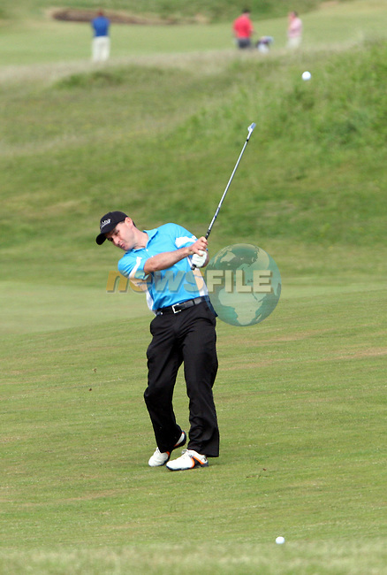Mark Mullen of Wexford Golf Club hitting onto 3rd green on day 2 of the 2010 East of Ireland Amateur Golf Competition in Co.Louth Golf Club...Photo NEWSFILE/Jenny Matthews.(Photo credit should read Jenny Matthews/NEWSFILE)....This Picture has been sent you under the condtions enclosed by:.Newsfile Ltd..The Studio,.Millmount Abbey,.Drogheda,.Co Meath..Ireland..Tel: +353(0)41-9871240.Fax: +353(0)41-9871260.GSM: +353(0)86-2500958.email: pictures@newsfile.ie.www.newsfile.ie.FTP: 193.120.102.198.