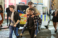 Pictured: A man gets a piggy back ride. Sunday 31 December 2017 and 01 January 2018<br /> Re: New Year revellers in Wind Street, Swansea, Wales, UK