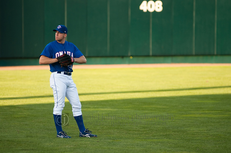 June 29, 2009 -- Omaha Royals left fielder Scott Thorman, from Cambridge, Ontario, checks out the scoreboard between pitches against the Albuquerque Isotopes in a minor league professional baseball game on Monday June 29, 2009 in Omaha, Nebraska. PHOTO/Daniel Johnson