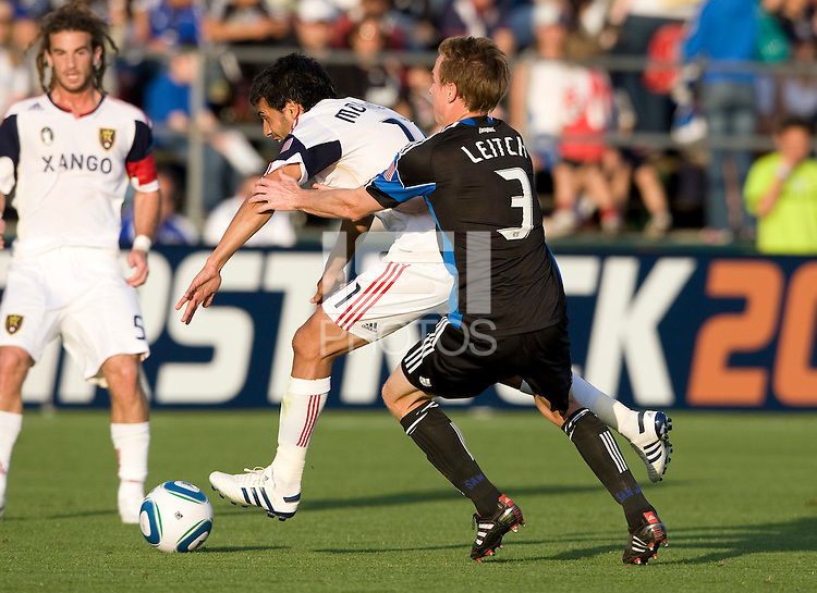 Javier Morales of Real Salt Lake dribbles the ball away from Chris Leitch of Earthquakes during the game at Buck Shaw Stadium in Santa Clara, California on March 27th, 2010.   Real Salt Lake defeated San Jose Earthquakes, 3-0.