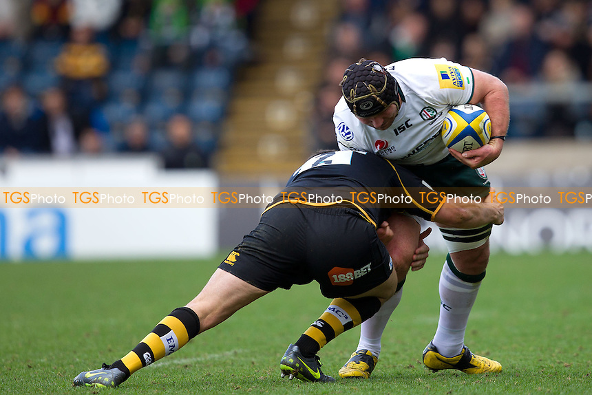 Rob Webber of London Wasps RFC halts the progress of James Buckland of London Irish RFC - London Wasps RFC vs London Irish RFC - Aviva Premiership Rugby at Adams Park, Wycombe Wanderers FC - 03/03/12 - MANDATORY CREDIT: Ray Lawrence/TGSPHOTO - Self billing applies where appropriate - 0845 094 6026 - contact@tgsphoto.co.uk - NO UNPAID USE.
