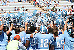 02 September 2006: UNC players hold their helmets aloft before the game. The University of North Carolina Tarheels lost 21-16 to the Rutgers Scarlett Knights at Kenan Stadium in Chapel Hill, North Carolina in an NCAA Division I College Football game.
