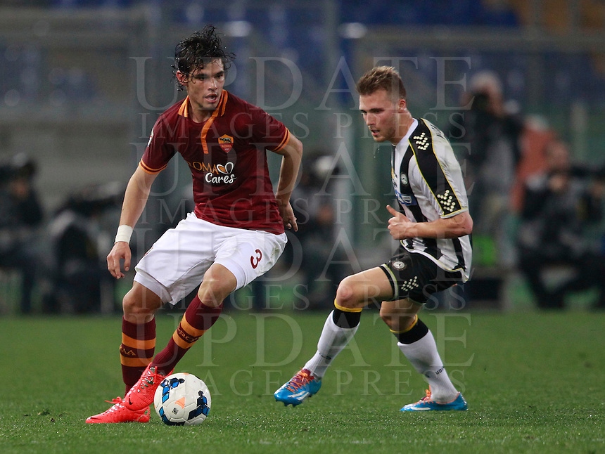 Calcio, Serie A: Roma vs Udinese. Roma, stadio Olimpico, 17 marzo 2014.<br /> AS Roma defender Dodo', of Brazil, is chased by Udinese defender Widmer Silvan, of Switzerland, during the Italian Serie A football match between AS Roma and Udinese at Rome's Olympic stadium, 17 March 2014.<br /> UPDATE IMAGES PRESS/Isabella Bonotto