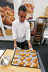 An exhibitor shows his products at the France booth during the 42nd International Food and Beverage Exhibition (FOODEX JAPAN 2017) in Makuhari Messe International Convention Complex on March 8, 2017, Chiba, Japan. About 3,282 companies from 77 nations are participating in the Asia's largest food and beverage trade show. This year organizers expect 77,000 visitors for the four-day event, which runs until March 10. (Photo by Rodrigo Reyes Marin/AFLO)