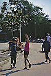 Kids On Street Waving