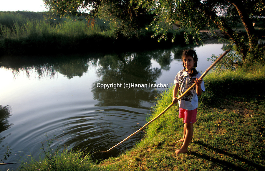 Israel, Upper Galilee, a girl by the Jordan river