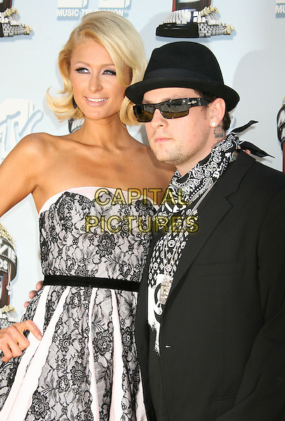BENJI MADDEN.Arrivals - 2008 MTV Movie Awards held at Gibson Amphitheatre, Universal City, California, USA, 01 June 2008..half length black hat sunglasses and white print top tattoos hand scarf.CAP/ADM/MJ.©Michael Jade/Admedia/Capital Pictures