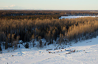 A team nears the Yentna checkpoint on the Yentna river a few hours after leaving the re-start line in Willow during the 2011 Iditarod.