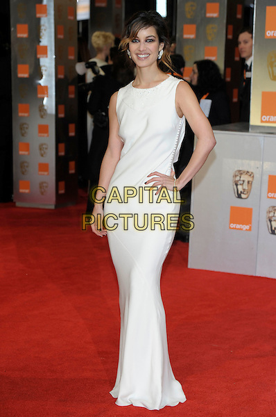 Berenice Marlohe.The Orange British Academy Film Awards ( BAFTA ), Royal Opera House, Bow St., London, England..February 12th, 2012.baftas full length dress hand on hip white .CAP/PL.©Phil Loftus/Capital Pictures.