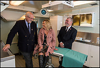 BNPS.co.uk (01202 558833)<br /> Pic: PhilWilkinson/BNPS<br /> <br /> Back in the sickbay - Julie Harding (McPherson) is reunited with surgeon Eric Birkbeck(l) and his assistany Andy Travis(r) in the sickbay of the RY Britannia.<br /> <br /> A navy wren who made history when she was transferred to Royal Yacht Britannia for emergency treatment in its sick bay has told how she was pampered by the Queen.<br /> <br /> Her Majesty and Prince Philip visited Julie Harding on her sick bed, arranged for the Royal band to play to her and showered her with gifts and food after she unexpectedly interrupted their summer cruise in 1992.<br /> <br /> The 18-year-old wren was serving on HMS Brilliant which was escorting Britannia around the Western Isles of Scotland when she suffered a gruesome injury to her fingers in an accident on board.<br /> <br /> Due to a lack of medical resources on the Royal Navy frigate, Mrs Harding was transferred to the Royal yacht so she could be operated on by the Queen's doctors.<br /> <br /> Mrs Harding has returned to Britannia, now a floating museum at Leith, to be reunited with the medics who treated her to mark the 25th anniversary of the event.