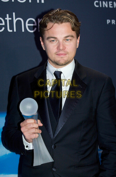 LEONARDO DI CAPRIO.Cinema for Peace 2009, Konzerthaus, Gendarmenmarkt, Berlin, Germany..February 9th, 2009.half length black suit jacket goatee facial hair dicaprio award trophy .CAP/PPG/JH.©Jens Hartmann/People Picture/Capital Picturess